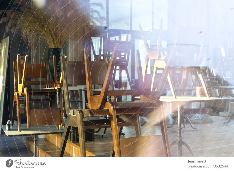 restaurant chairs in a pile lockdown Deserted Restaurant Interior shot Closed Tourism Gastronomy Empty Loneliness Roadhouse patience endure Wait Insecure Table