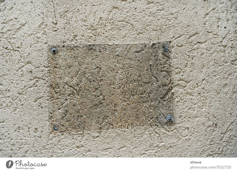 plastered wall with a visibly removed sign Wall (building) Wall (barrier) take off light-dark Rawplug trace Facade Assault Subdued colour