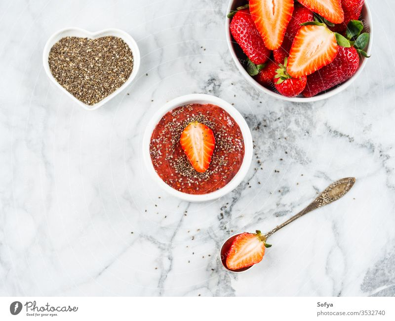 Strawberry chia jam made with chia seeds strawberry low sugar detox sweet dessert food healthy homemade jar summer red fruit jelly marble organic ingredient