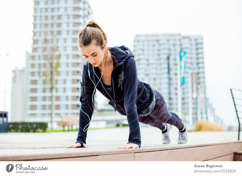 Fit girl doing plank exercise outdoor in the park fit activity woman athlete athletic young outdoors lifestyle healthy fitness active care urban people action