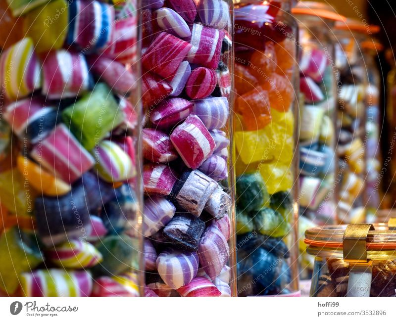 Coloured sweets in jars Candy Sweets Sugar Nutrition Addiction narcotic Red Multicoloured nib sweets and biscuits Toothache Yellow green Dentist Muddled Sticky