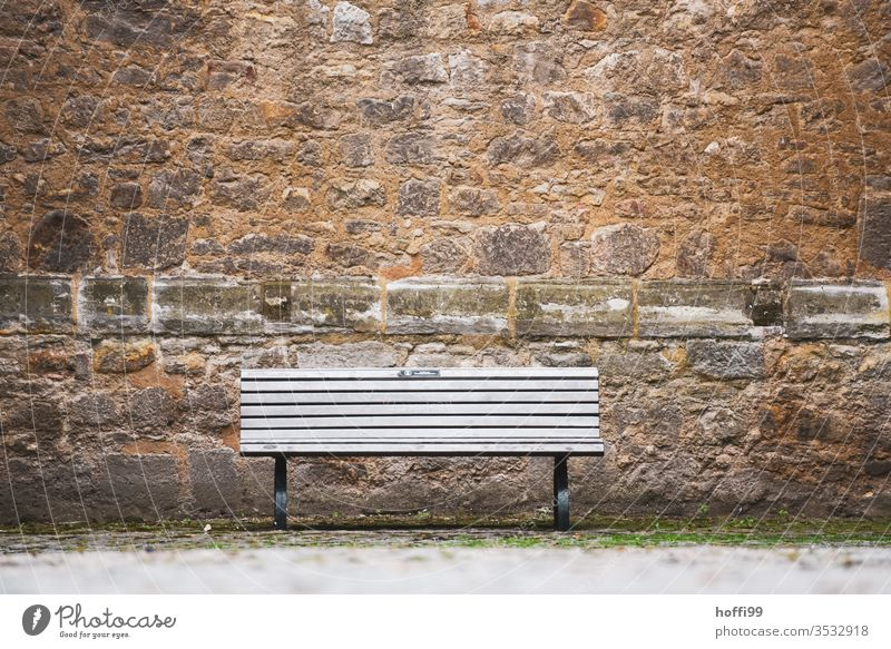 the bank is empty and waiting for visitors Bench Bench seat Castle wall sandstone wall Standing stone Sandstone Facade Wall (barrier) Wall (building) Old town