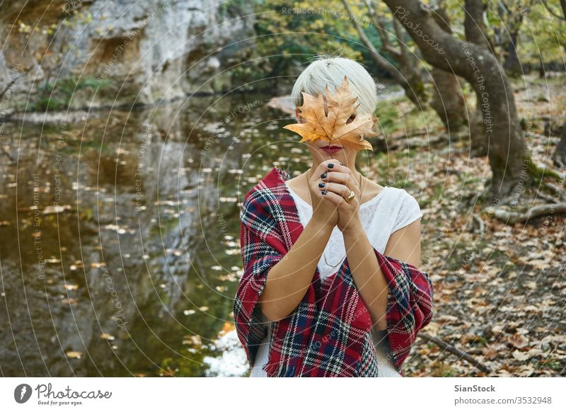 Blonde woman hold an autumn leave. light firework celebration bengal hand xmas new girl christmas spark eve holding beautiful sparkler year young holiday lake