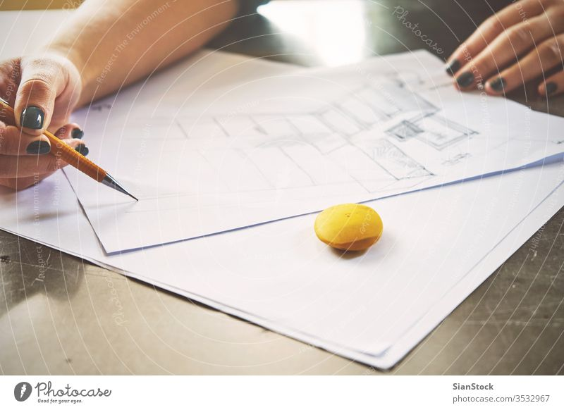 Architect woman sketching in her office business workplace hands desk table working technology notebook view coffee up writing typing internet using female