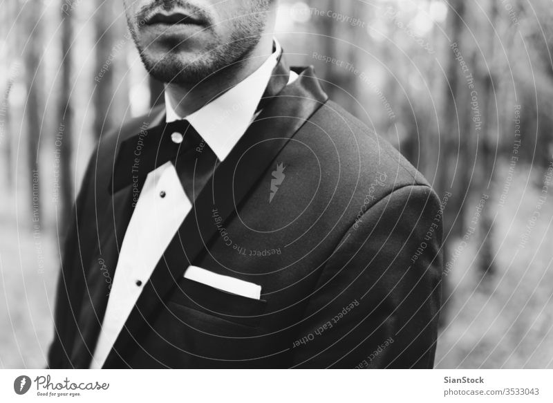 Groom at wedding tuxedo in the forest groom black white man elegant happy jacket b&w background person tie portrait handsome dress young people fashion luxury