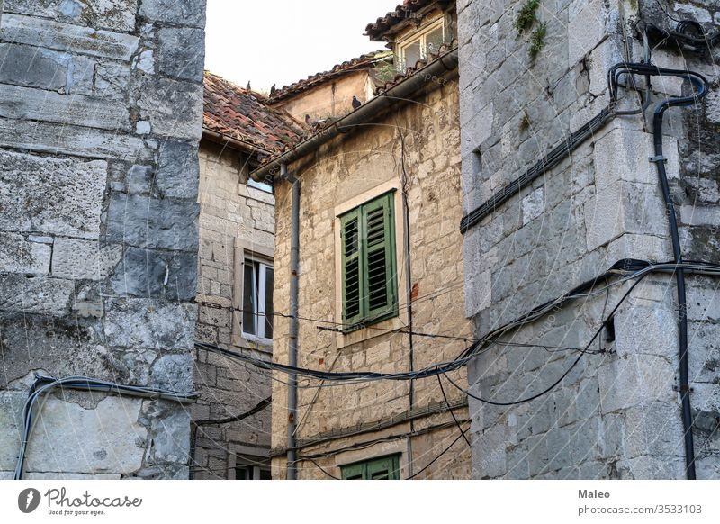Stone buildings in the old district of Split in Croatia city croatia split stone town architecture view ancient house street urban historic summer wall window