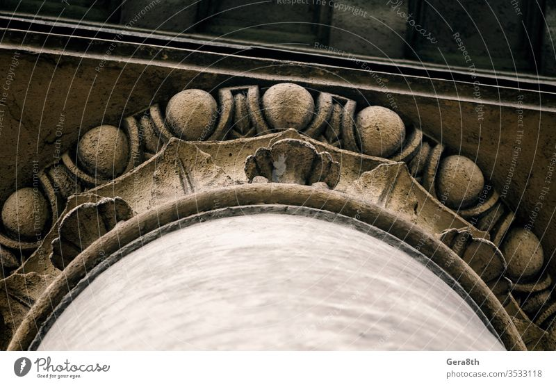 part of the decor of an old antique column abstract ancient architecture backdrop background ball bottom view brown building city close close up color concrete