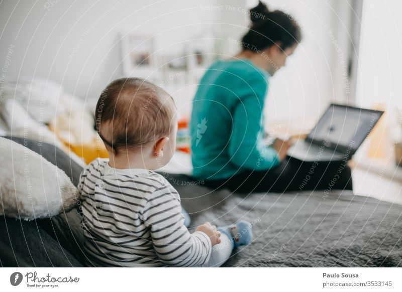 Baby watching Mother working from home Working at home confinement Quarantine Quarantine period Home Family & Relations coronavirus Child woman caucasian indoor