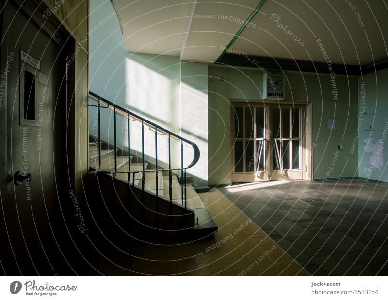 Staircase in the light, between the very top and the very bottom Stairs Shadow Lanes & trails Story Retro Style Shaft of light Architecture Banister Symmetry