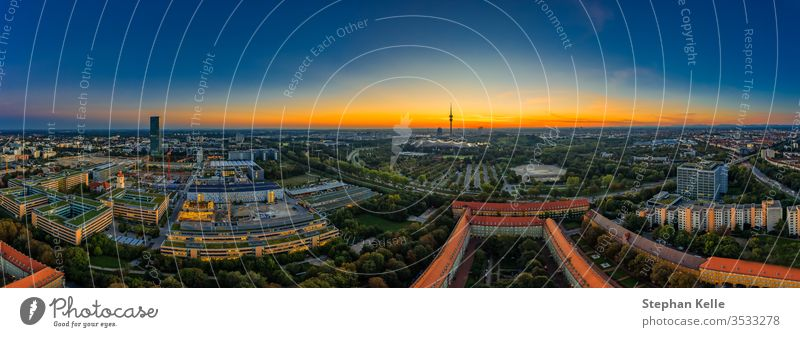 View over Munich as a sunrise panorama with office buildings in the foreground business high angle Park Drone Sun aerial road german popular living capital