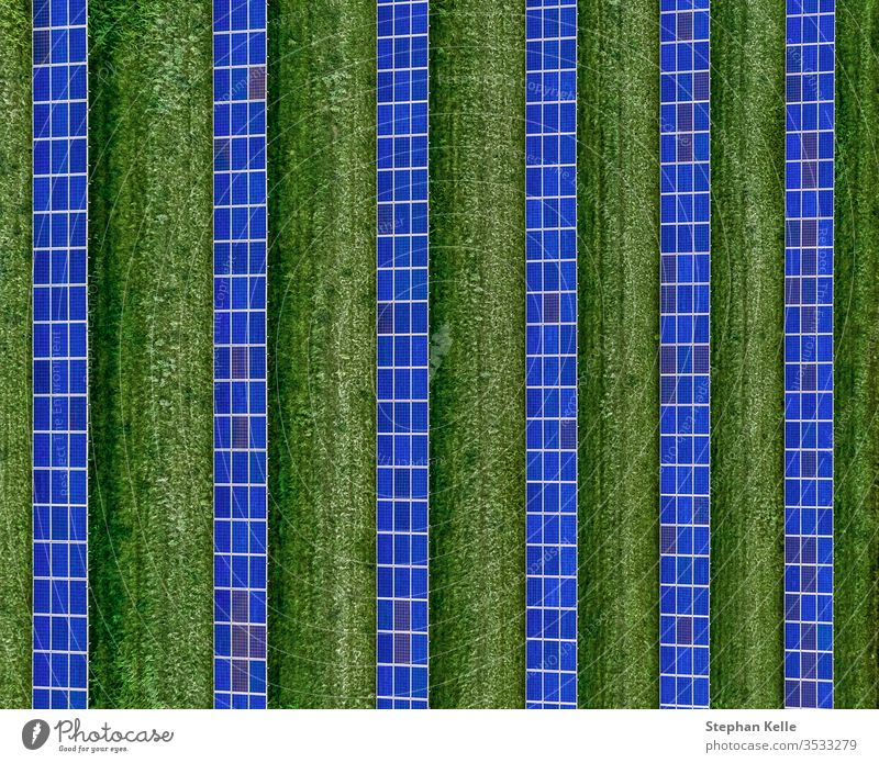 A plan view of solar panels set in an solar farm, top shot made by a drone. alternative energy environment friendly line symmetry solar array technology
