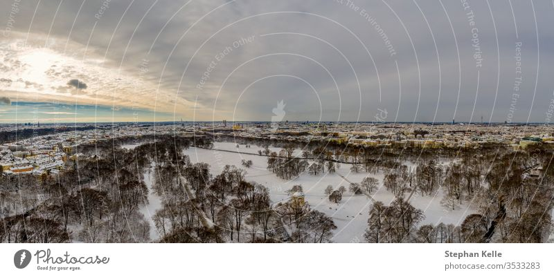 Aerial view of Munich at winter season in the snow, Germany above trees stream path nature munich landscape germany cold aerial bavaria drone surrounded high
