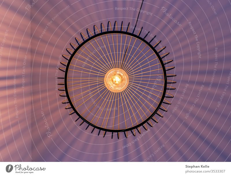 Geometrically arranged light beams of a lamp photographed exactly vertically from below. Wall (building) Lamp Striped Abstract Under Modern natural overshadow