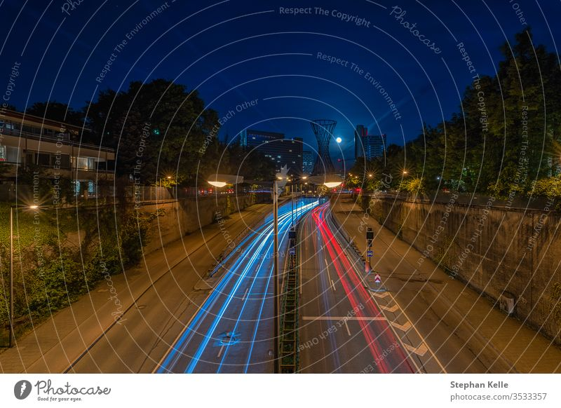 Night drive with light trails of cars in the bavarian cpaital Munich by low light. night abstract traffic city munich urban minga monaco muenchen germany travel