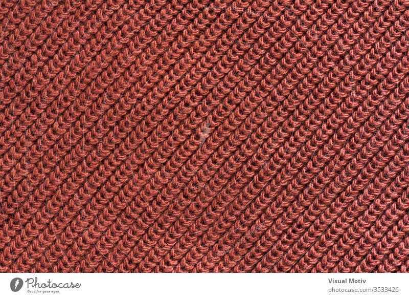 Texture of a red wool knitted fabric textile textured fashion background surface design abstract closeup nobody detail knitwear clothing material relief woolen