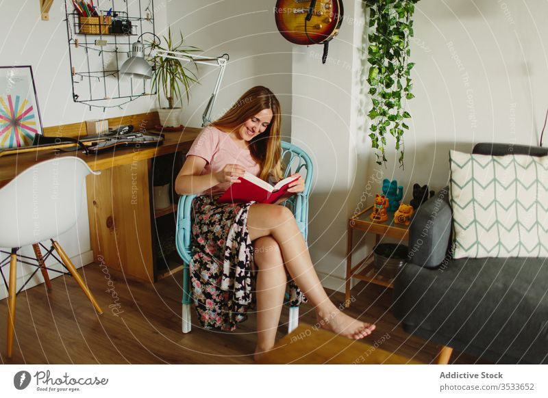 Woman reading book in living room woman cover shy cozy home rest hide face chair sit female barefoot literature lifestyle hobby relax interesting story novel