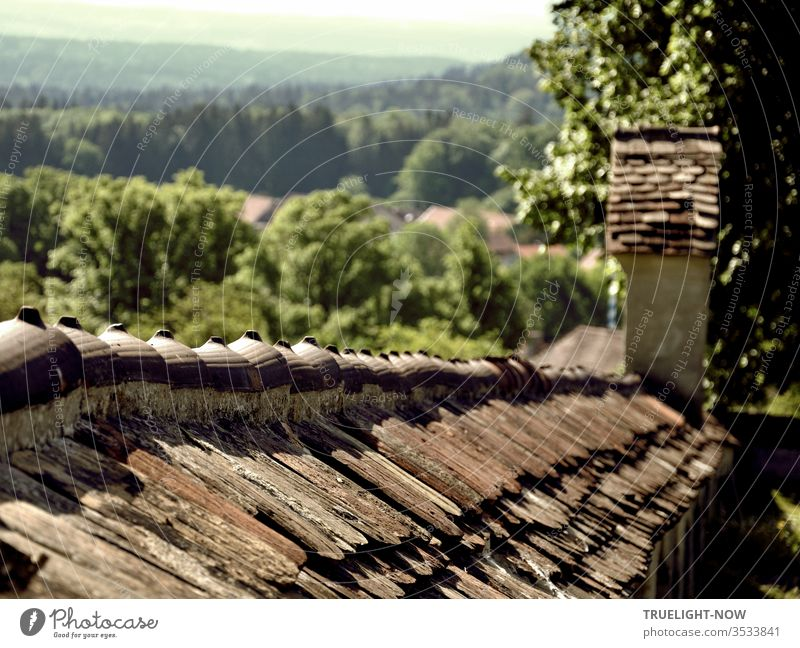 Nature and architecture   Ancient cemetery wall at the edge of the village of Wessobrunn with a wide view of the green landscape of Upper Bavaria Old