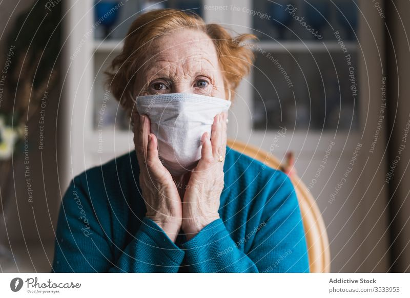 Aged woman in medical mask standing and looking at camera hospital infection disease virus protect room risk group clinic senior aged self isolation quarantine