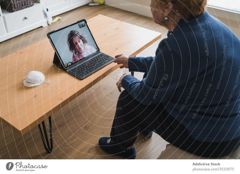 Old woman communicating with daughter on video chat on laptop video call home senior meeting using online remote distance coronavirus isolation quarantine