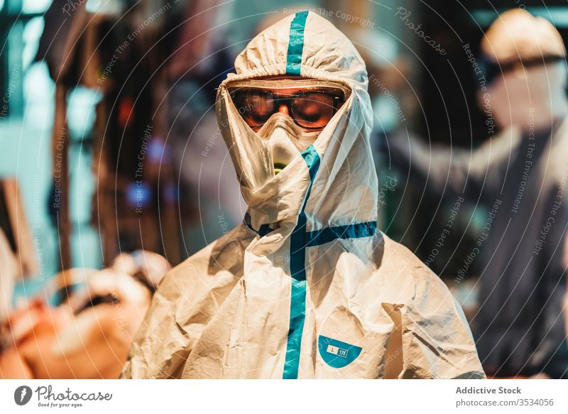 Professional doctor in protective uniform leaving operating room after operation surgeon sad mask tired devastated clinic upset serious specialist treat surgery