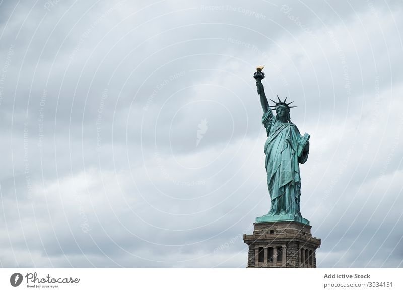 Statue of Liberty against cloudy sky statue liberty architecture symbol city landmark famous freedom new york usa america ny travel tourism attract sightseeing