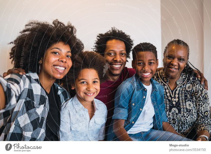 Multigenerational family taking selfie at home. together happy multigenerational cute smile grandmother love memories four black son lifestyle photo cheerful