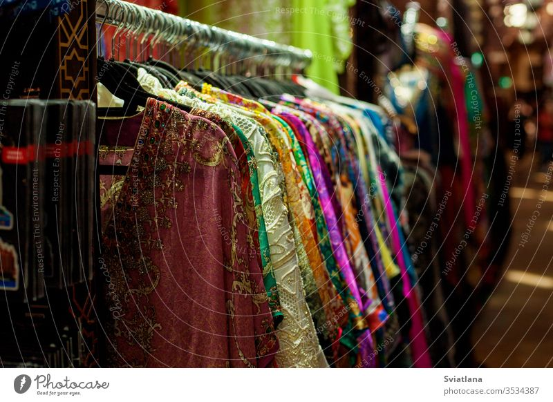 Sale of sarees of different colors on the eastern market arabic architecture art asian bazaar building clothes clothing collar culture cup decoration design