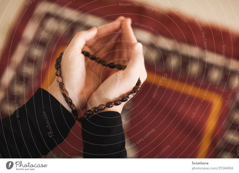 Prayer hands of a woman holding a rosary beads muslim symbol pray religion faith holy islam prayer allah god meditation Ramadan traditional white arabic