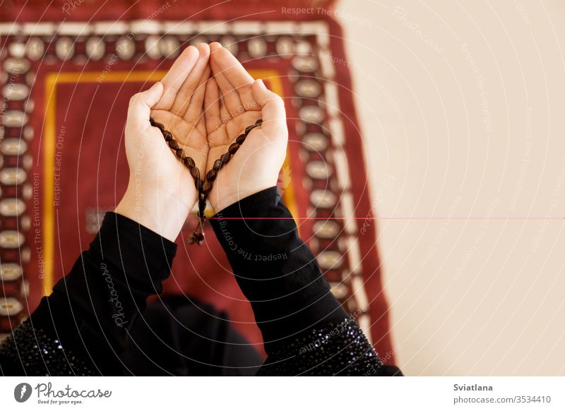 Prayer hands of a woman holding a rosary, with space for text beads muslim symbol pray religion faith holy islam prayer allah god meditation Ramadan traditional