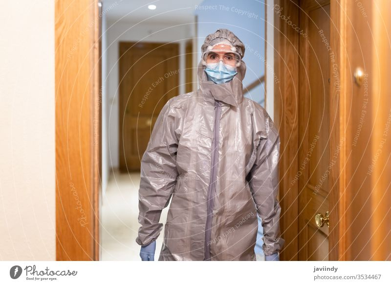 Doctor in PPE Personal Protective Equipment coming into the house doctor home ppe coronavirus medical concerned hospital equipment laboratory protective