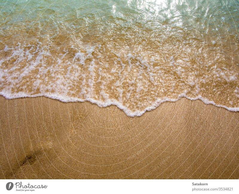 White bubble of Sea wave on the beach sand fine sea ocean ebb sun nature blue tide splash movement clear tropical relax foam beautiful relaxation summer