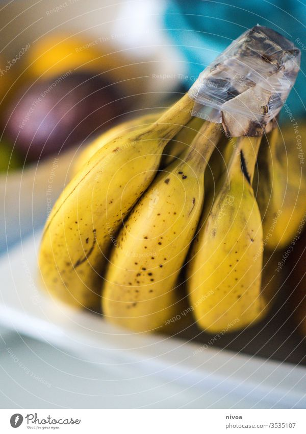 bananas Banana Bananas Fruit Lemon passion fruit Bowl Dish Kitchen Yellow close up Healthy Vitamin Close-up Citrus fruits Colour photo citrus Nutrition Lime