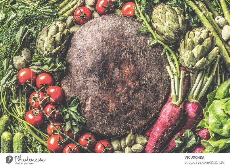 Various  vegetables around vintage wooden plate. Top view. Frame made with organic veggies. Healthy clean food concept various top view frame healthy copy space