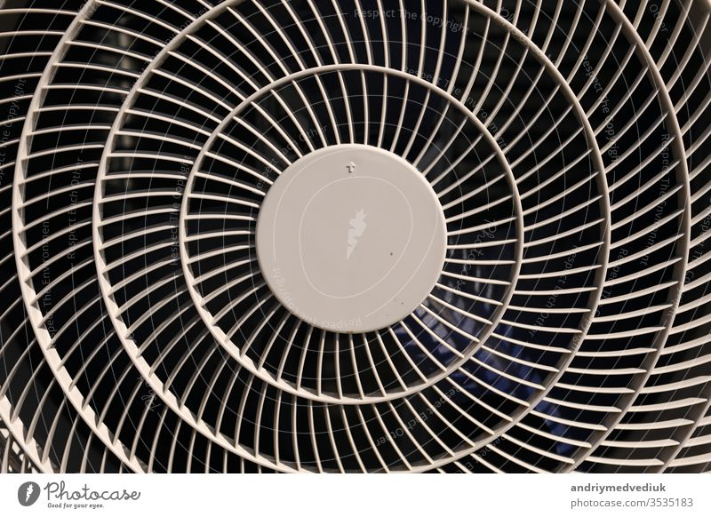 close up of air conditioner texture. Air condition cover texture. Gray protective plastic cover for air conditioner fan. Detail of industrial equipment. Close-up, abstract background, lattice pattern