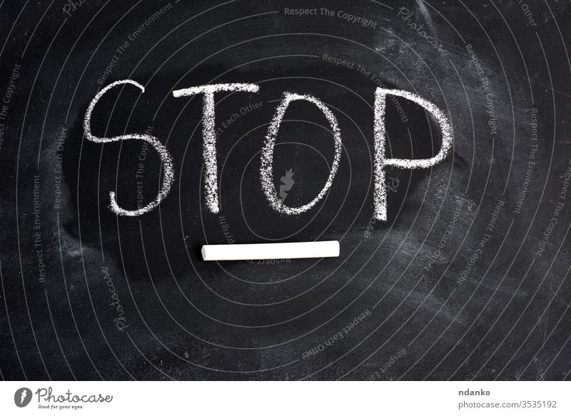 inscription english stop with white chalk on a black blackboard word wooden concept attention letter business communication text caution sign warning