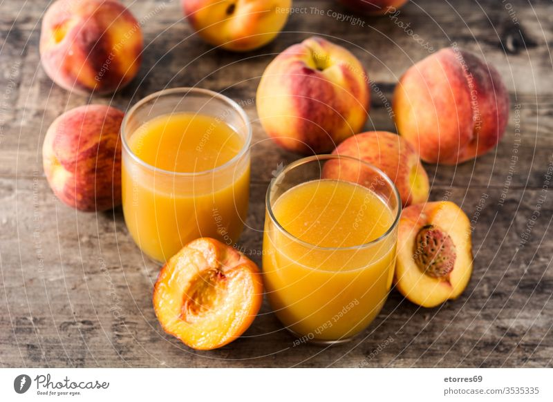 Natural peach juice in glass on wooden table beverage breakfast cup diet drink food fresh freshness fruit healthy juicy liquid nutrition organic refreshment