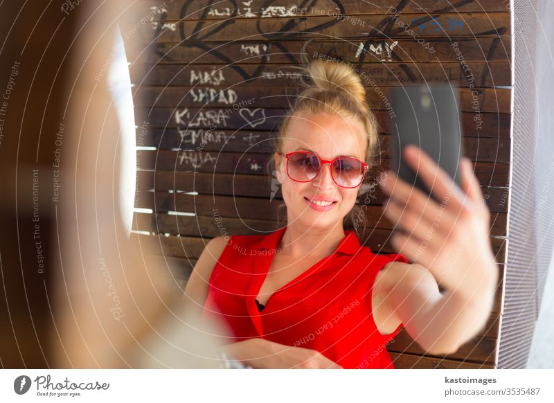 Young cheerful lady taking selfie. woman portrait fresh urban girl carefree relaxed caucasian casual modern female beautiful young adult trendy stylish leisure