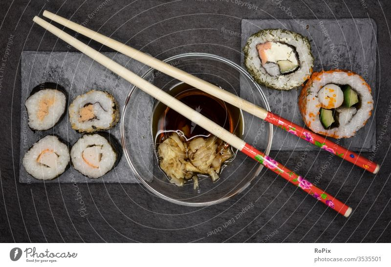 Sushi and chopsticks Fish Rice fish Ocean Fisherman Japan food Eating food products Algae Flake Nutrition Healthy health Fitness Fat Fatty acids Herring Salmon