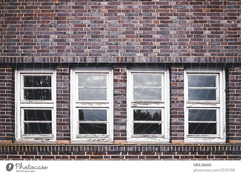 old flaked muntin windows in a clinker facade geometric Symetric Geometry Architecture symmetry façade Wooden window wood flaking paint Lattice window Window