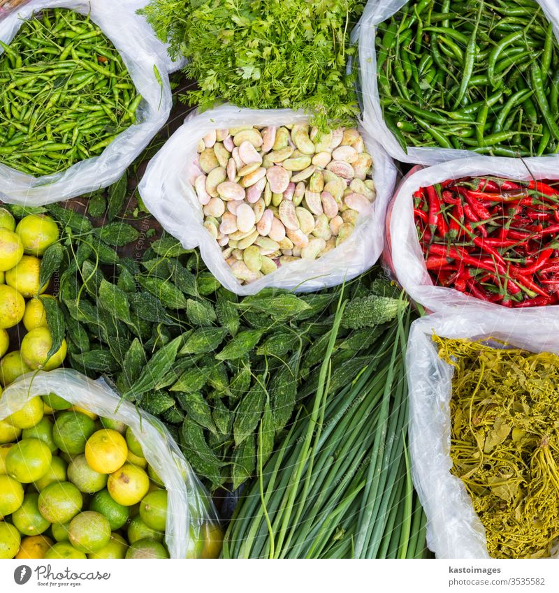 Farmers market with various domestic colorful fresh fruits and vegetable. food marketplace farm vegetarian cucumbers beans variation basket stand background