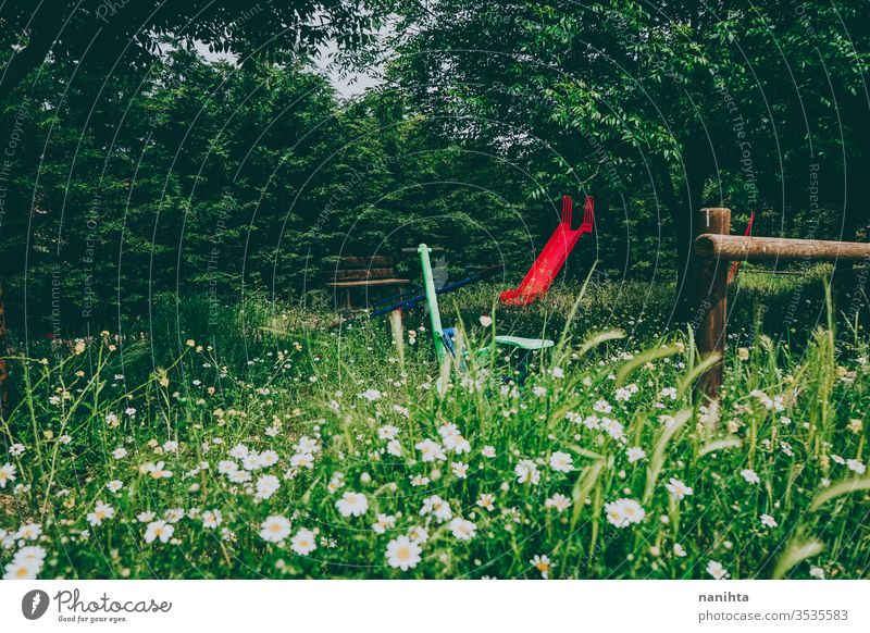 Abandoned park in spring full of flowers abandoned deserted beautiful bloom springtime wild rural rustic post post apocalyptic green beauty no people slide play