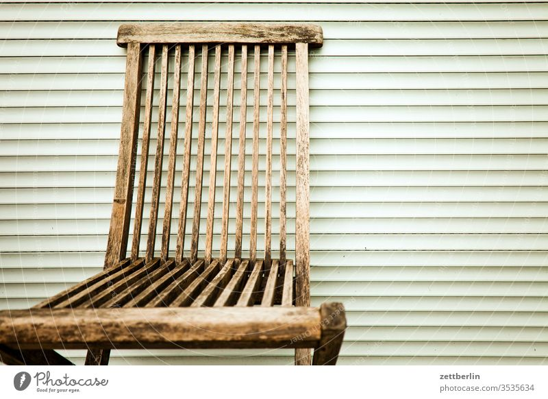 Folding chair in front of closed blinds Garden chair Chair Relaxation Venetian blinds Empty Free allotment Garden allotments Deserted tranquillity Garden plot