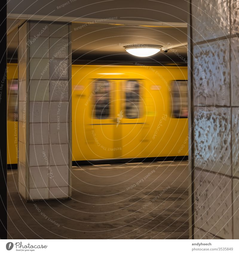 The old yellow berlin subway enters the subway station architecture arrival arrive arrives Berlin blur blur effect blurred building city design destination door