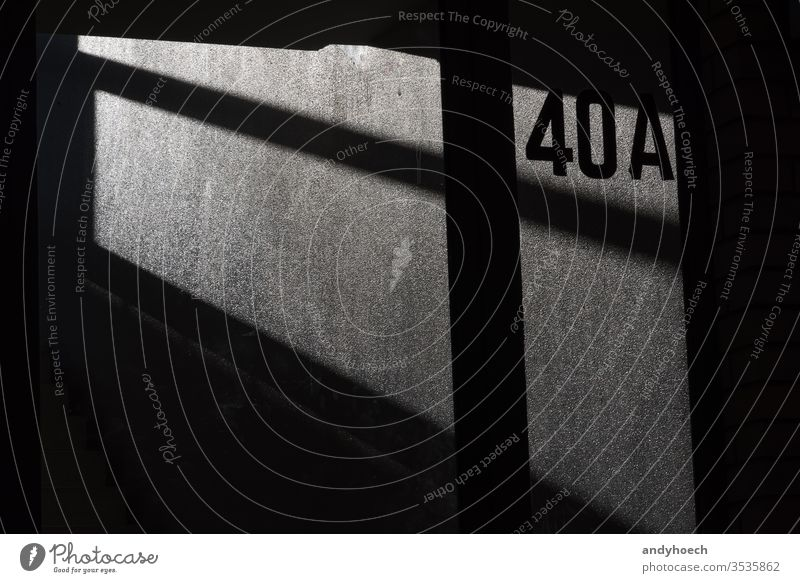 The 40A on the house wall in light and shadow abstract address architecture Background backgrounds black building built structure city communication concept