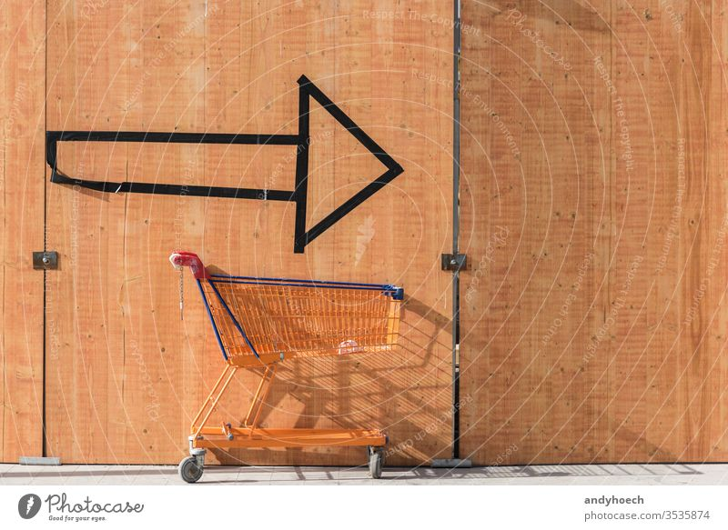 With the shopping cart always on the arrow after shoppingtour action Background benefits buy buying choice communication concept consumer consumerism copy space
