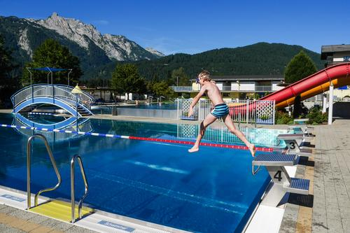 Outdoor pool in the mountains Alps vacation Vacation mood Open-air swimming pool Swimming pool Vacation & Travel Swimming & Bathing Exterior shot Water Summer