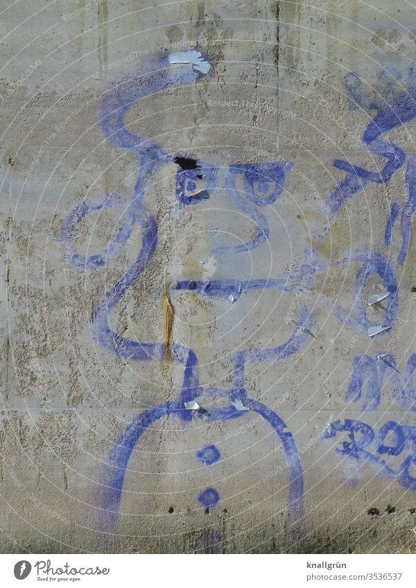 Washed-out blue graffiti of a serious looking woman on a grey concrete wall Graffiti Woman Art Adults Wall (building) Exterior shot Wall (barrier) Colour photo