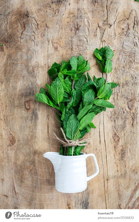 fresh aromatic herbs from above on old wood  background food organic green ingredient mint oregano parsley chive rosemary basil estragon leaf plant bouquet