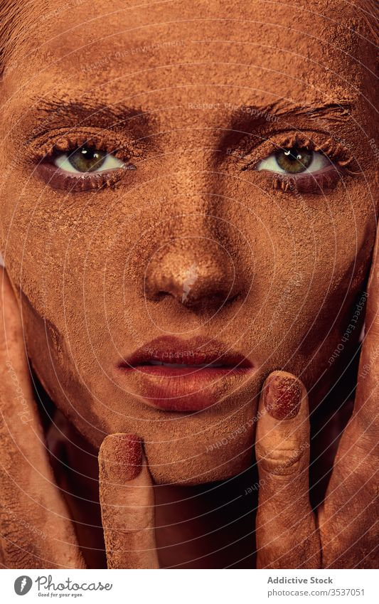 Female model with chocolate on face woman powder touch face concept cover treat sensual appearance female young beautiful human face cosmetic perfect natural