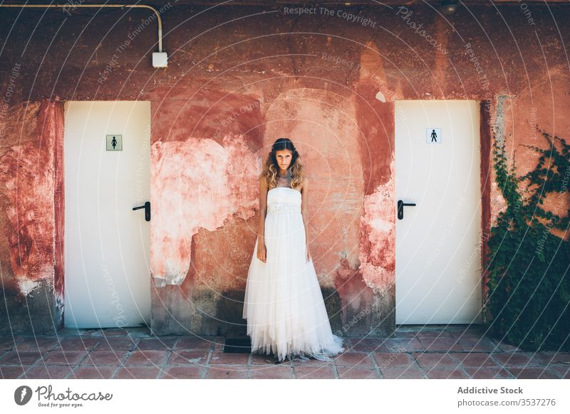 Sensual young bride in white dress standing near shabby wall woman red toilet wedding elegant romantic charming style beautiful marriage attractive event pretty